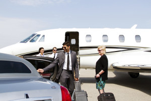 Lady being assisted by chauffeur